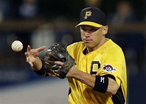Pittsburgh Pirates shortstop Clint Barmes loses control of the ball, allowing Tampa Bay Rays' Matt Joyce to reach first on an error, in the seventh inning of an exhibition spring training baseball game in Port Charlotte, Fla., Monday, March 25, 2013. (AP Photo/Elise Amendola)