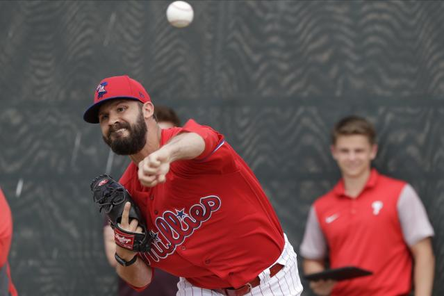Philadelphia Phillies' Adam Morgan delivers a pitch during a spring training baseball workout Wednesday, Feb. 19, 2020, in Clearwater, Fla. (AP Photo/Frank Franklin II)