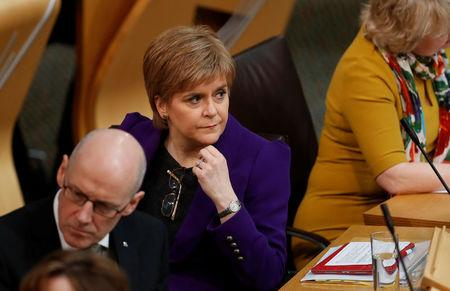 Scotland's First Minister Nicola Sturgeon and Deputy First Minister John Swinney listen to the referendum debate in Edinburgh