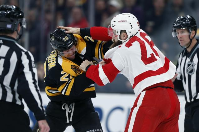Boston Bruins' Joakim Nordstrom (20) fights Detroit Red Wings' Luke Witkowski (28) during the second period of an NHL hockey game in Boston, Saturday, Dec. 1, 2018. (AP Photo/Michael Dwyer)