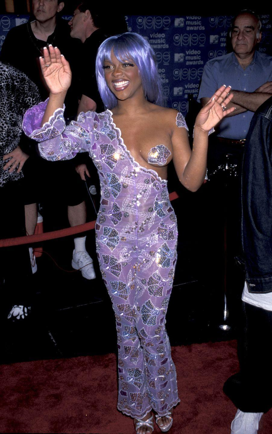 """<p>Speaking of not wearing many clothes, Lil Kim rocked the nipple sticker trick <a href=""""https://www.cosmopolitan.com/uk/fashion/celebrity/news/a38195/miley-cyrus-jimmy-kimmel-topless-nipple-stickers/"""" rel=""""nofollow noopener"""" target=""""_blank"""" data-ylk=""""slk:Miley Cyrus is trying to make happen now"""" class=""""link rapid-noclick-resp"""">Miley Cyrus is trying to make happen now</a>, all the way back in 1999.</p>"""