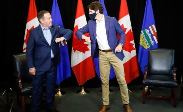 Prime Minister Justin Trudeau, right, bumps elbows with Alberta Premier Jason Kenney as the two meet in Calgary, Alta. Kenney has said Alberta won't have an internal vaccine passport program. (Jeff McIntosh/The Canadian Press - image credit)