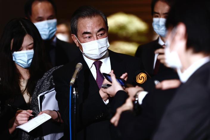 China's Foreign Minister Wang Yi speaks to media after meeting with Japan's Prime Minister Yoshihide Suga in Tokyo, Wednesday, Nov. 25, 2020. (Behrouz Mehri/Pool Photo via AP)