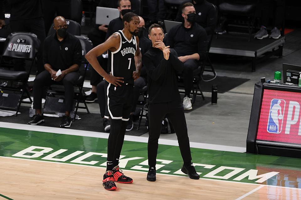 Kevin Durant and Steve Nash talk on the sideline during Game 4.
