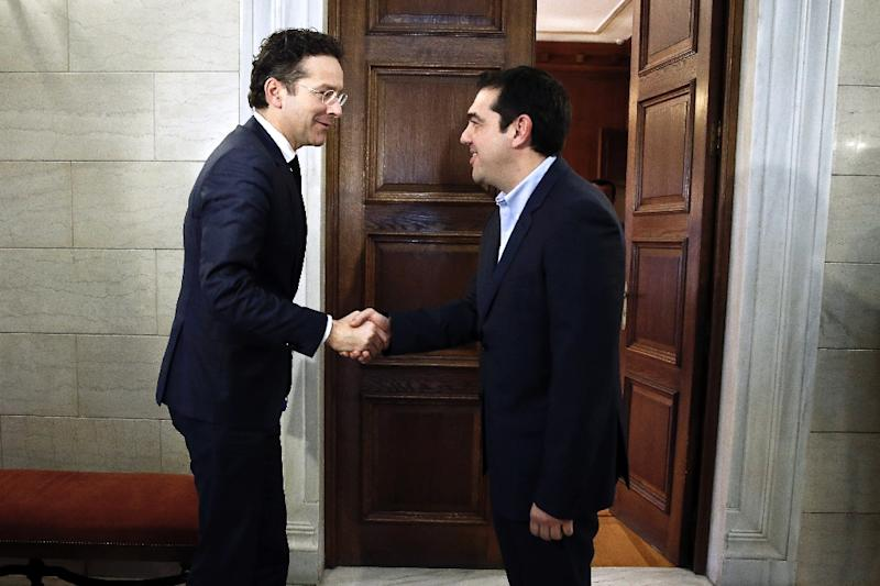 "Eurogroup chairman Jeroen Dijsselbloem (L), seen with Greek Prime Minister Alexis Tsipras in 2015, said ""I have received a letter in which my Greek colleague has confirmed his commitment to previous agreements"" on debt measures (AFP Photo/PETROS GIANNAKOURIS)"