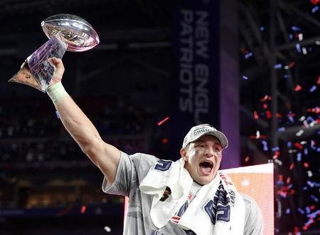 FILE PHOTO: New England Patriots tight end Rob Gronkowski holds up the Vince Lombardi Trophy after his team defeated the Seattle Seahawks in the NFL Super Bowl XLIX football game in Glendale, Arizona, February 1, 2015. REUTERS/Lucy Nicholson/File Photo