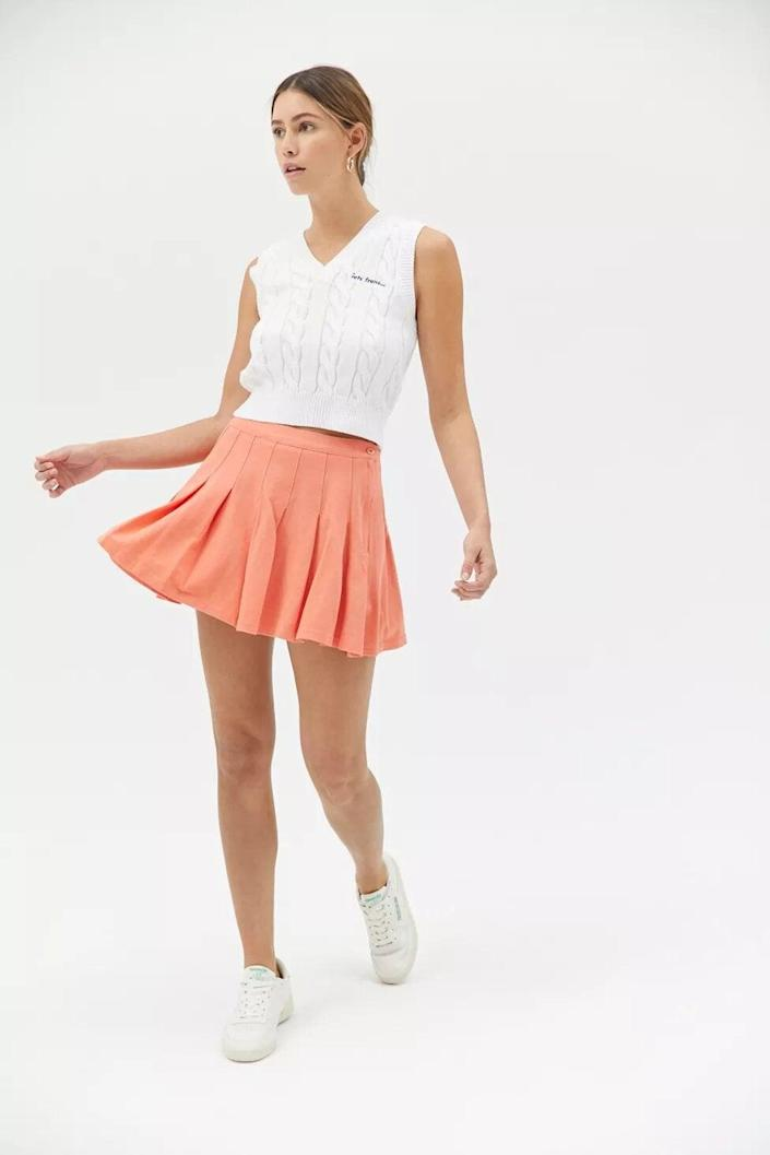"""<br><br><strong>Urban Outfitters</strong> Katie Tennis Mini Skirt, $, available at <a href=""""https://go.skimresources.com/?id=30283X879131&url=https%3A%2F%2Fwww.urbanoutfitters.com%2Fshop%2Fuo-katie-tennis-mini-skirt"""" rel=""""nofollow noopener"""" target=""""_blank"""" data-ylk=""""slk:Urban Outfitters"""" class=""""link rapid-noclick-resp"""">Urban Outfitters</a>"""