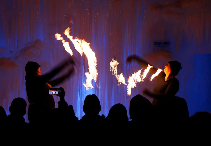 Fire dancers perform at Ice Castles in North Woodstock, N.H. The winter wonderland is one of six in North America. (Photo: Robert F. Bukaty/AP)