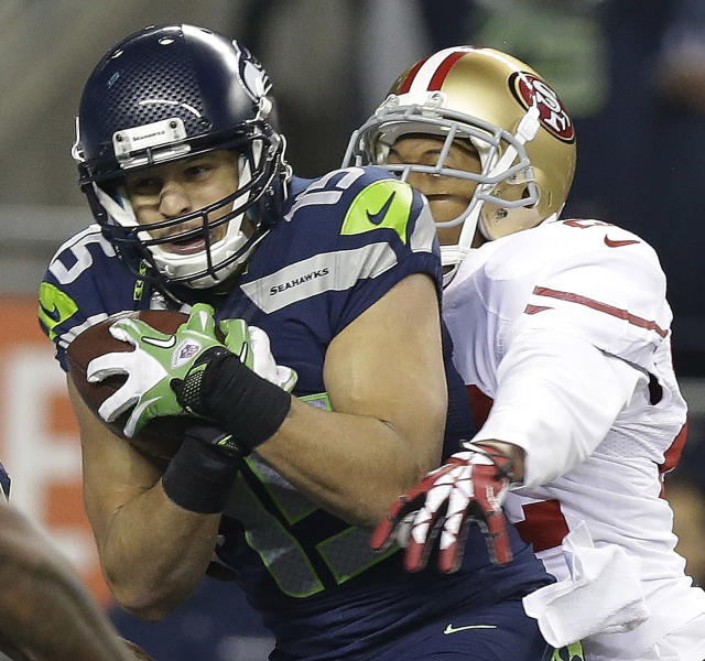 Seattle Seahawks' Jermaine Kearse catches a touch-down pass in front of San Francisco 49ers' Carlos Rogers during the second half of the NFL football NFC Championship game Sunday, Jan. 19, 2014, in Seattle. (AP Photo/Elaine Thompson)