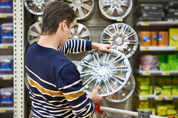 Man looking at products in an automotive retail store