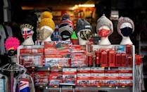 Face coverings are displayed for sale in the window of a souvenir shop in central London, on November 22, 2020