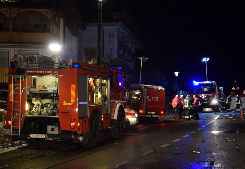Firefighters attend to the scene where a male driver of a car hit a group of German tourists, killing six in Lutago