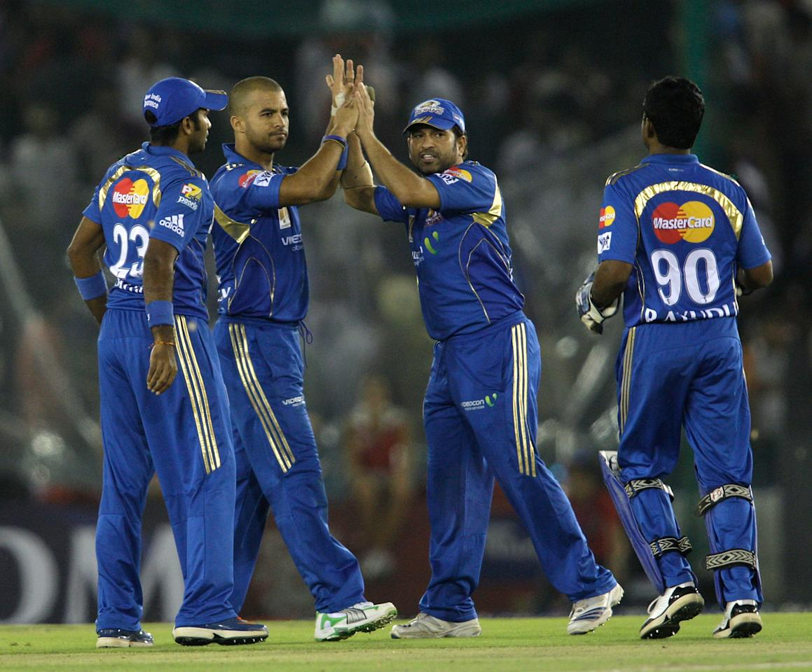 MOHALI, INDIA - APRIL 9:J P Duminy and Sachin Tendulkar of the Indians celebrate the wicket of Adrian Barath during the 2010 DLF Indian Premier League T20 group stage match between Mumbai Indians and Kings IX Punjab played at Punjab Cricket Association Stadium, Mohali on April 09, 2010 in Mohali, India.  (Photo by Graham Crouch-IPL 2010/IPL via Getty Images)