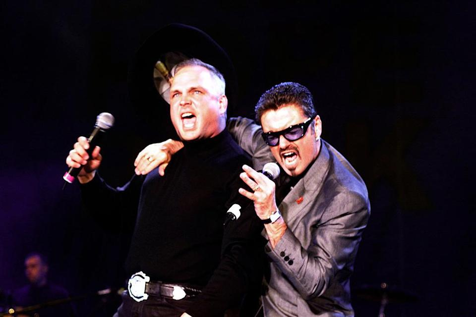 <p>Garth Brooks and George Michael sing during the <i>Equality Rocks</i> concert on April 29, 2000, at RFK Stadium in Washington, D.C. (Photo: Mazur/WireImage) </p>