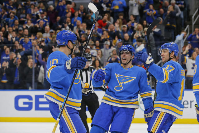 St. Louis Blues' Jaden Schwartz, right, celebrates with David Perron, middle and Brayden Schenn after scoring a goal against the Nashville Predators during the second period of an NHL hockey game Saturday, Feb. 15, 2020, in St. Louis. (AP Photo/Billy Hurst)