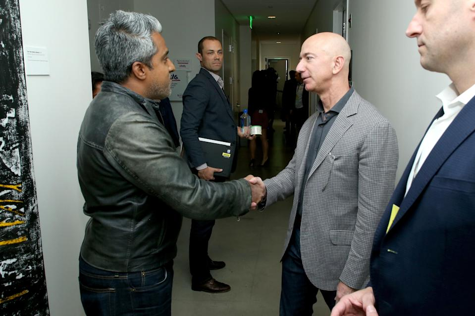 SAN FRANCISCO, CA - OCTOBER 15: Anand Giridharadas (L) and Jeff Bezos attend WIRED25 Summit: WIRED Celebrates 25th Anniversary With Tech Icons Of The Past & Future on October 15, 2018 in San Francisco, California. (Photo by Phillip Faraone/Getty Images for WIRED25 )