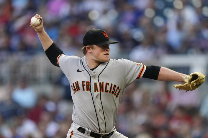 San Francisco Giants starting pitcher Logan Webb delivers in the first inning of a baseball game against the Atlanta Braves, Saturday, Aug. 28, 2021, in Atlanta. (AP Photo/John Bazemore)