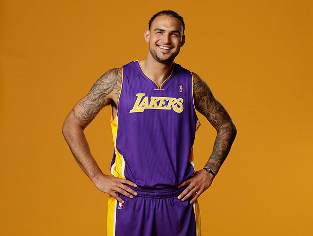 cba6b1e56 Lakers center Robert Sacre was the only one without a number at the ...