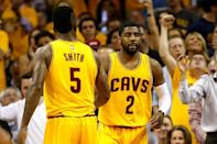 Kyrie Irving (R) of the Cleveland Cavaliers, seen in action in the first quarter against the Atlanta Hawks, during the Eastern Conference Finals of the NBA Playoffs, at Quicken Loans Arena in Cleveland, Ohio, on May 26, 2015 (AFP Photo/Gregory Shamus)