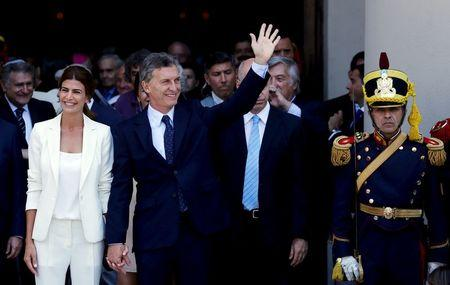 Argentina's President Macri waves alongside First Lady Awada outside Buenos Aires' Cathedral in Buenos Aires