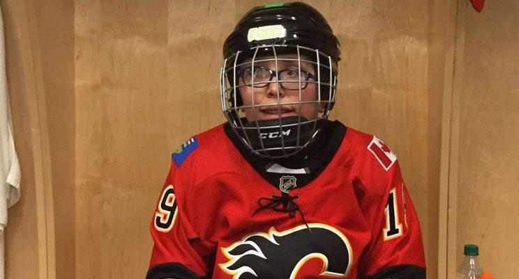 Fionn Daly sitting at his stall before Flames practice. (@FlamesFdn/Twitter)