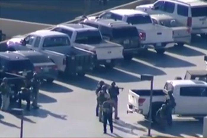 Armed officers in the airport carpark. Image: 7 News