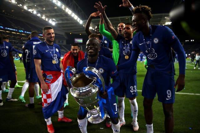 Man of the match N'Golo Kante lifts the trophy