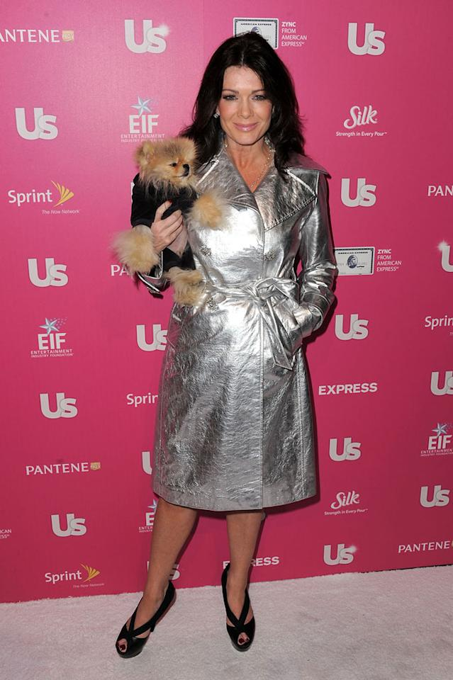 """As anyone who is a fan of the """"Beverly Hills Housewives"""" knows, Lisa Vanderpump -- who stepped out in a blinding silver trench -- doesn't go anywhere without her furry friend, Gigolo (aka Giggy). Jordan Strauss/<a href=""""http://www.wireimage.com"""" target=""""new"""">WireImage.com</a> - November 19, 2010"""