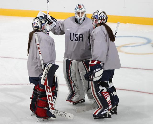 Team USA goaltenders Alex Rigsby and Nicole Hensley may have to change their helmets. REUTERS
