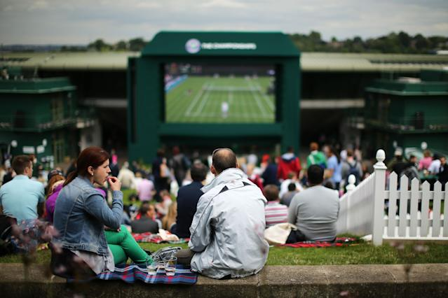 LONDON, ENGLAND - JUNE 24: Crowds gather on Murray Mount to watch the action on the big screen during day one of the Wimbledon Lawn Tennis Championships at the All England Lawn Tennis and Croquet Club on June 24, 2013 in London, England. (Photo by Dan Kitwood/Getty Images)