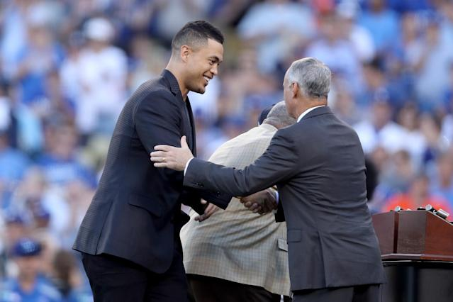 <p>Giancarlo Stanton #27 of the Miami Marlins shakes hands with Major League Baseball Commissioner Robert D. Manfred Jr. before game two of the 2017 World Series between the Houston Astros and the Los Angeles Dodgers at Dodger Stadium on October 25, 2017 in Los Angeles, California. (Photo by Christian Petersen/Getty Images) </p>