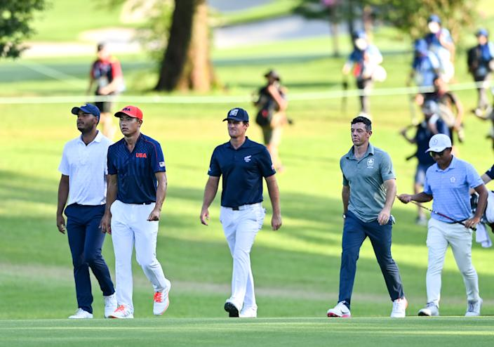 <p>Saitama , Japan - 1 August 2021; Bronze Medal play-off players, from left, Juan Sebastián Muñoz of Colombia, Collin Morikawa of USA, Mito Pereira of Chile, Rory McIlroy of Ireland and CT Pan of Chinese Taipei during the bronze medal play-off in round 4 of the men's individual stroke play at the Kasumigaseki Country Club during the 2020 Tokyo Summer Olympic Games in Kawagoe, Saitama, Japan. (Photo By Ramsey Cardy/Sportsfile via Getty Images)</p>