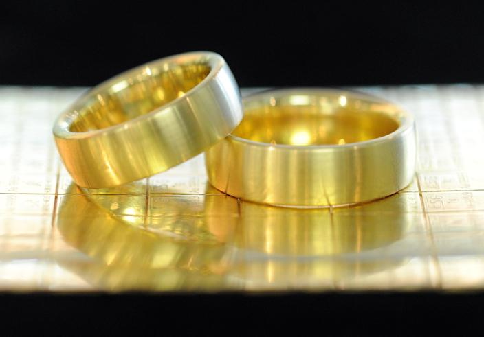 (ILLUSTRATION) An illustration dated 18 June 2013 shows gold rings on replica gold bars in a jewelry store in Pforzheim, Germany, 18 June 2013. The dramatic drop in price of gold is raising the hopes of jewelry lovers that jewelry prices will also fall. Photo: ULI DECK | usage worldwide (Photo by Uli Deck/picture alliance via Getty Images)