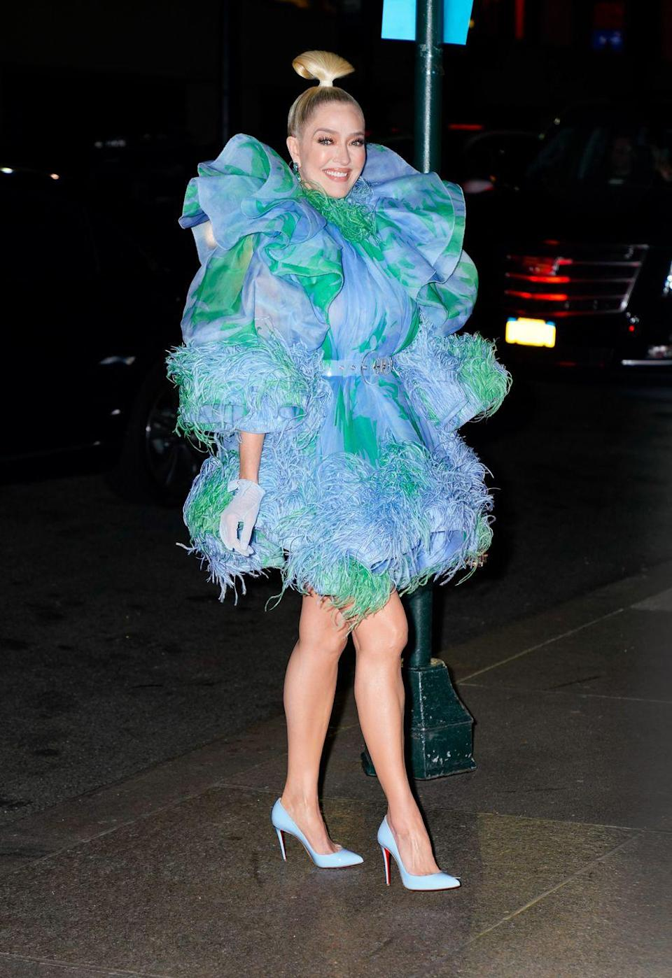 <p>The reality star wore a striking blue and green puffy dress by Marc Jacobs.</p>