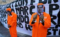 """Protestors celebrate outside the US District Court Southern District of New York on March 30, 2021 after Juan Antonio """"Tony"""" Hernandez, brother of the president of Honduras was sentenced to life for drug trafficking offenses"""