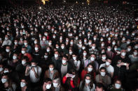 People using face masks attend a music concert in Barcelona, Spain, Saturday, March 27, 2021. Five thousand music lovers are set to attend a rock concert in Barcelona on Saturday after passing a same-day COVID-19 screening to test its effectiveness in preventing outbreaks of the virus at large cultural events. The show by Spanish rock group Love of Lesbian has the special permission of Spanish health authorities. While the rest of the country is limited to gatherings of no more than four people in closed spaces, the concertgoers will be able to mix freely while wearing face masks. (AP Photo/Emilio Morenatti)