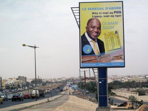 A bilboard shows a campaign advertisement for Oumar Sarr of the Democratic Party of Senegal (PDS) in the upcoming legislative elections in Dakar. Senegal will vote for new lawmakers in an election Sunday set to put more women than ever in the national assembly thanks to a new law which requires an equal gender balance on party lists