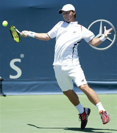 Ricardas Berankis, of Lithuania, returns the ball in a semifinals singles match against Marinko Matosevic, of Australia, at the Farmers Classic tennis tournament, Saturday, July 28, 2012, in Los Angeles. (AP Photo/Grant Hindsley)