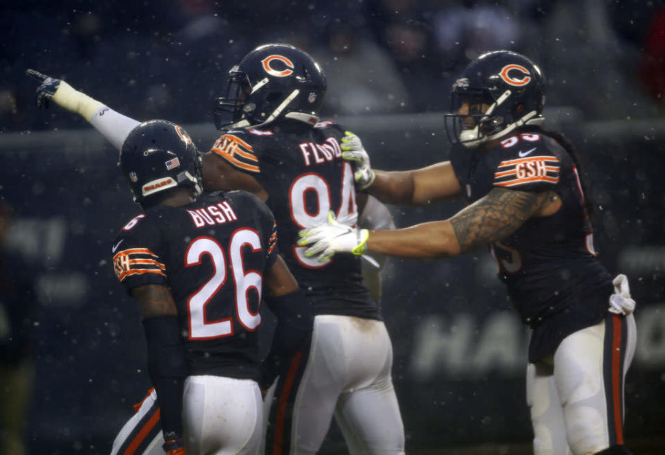 Dec 4, 2016; Chicago, IL, USA; Chicago Bears outside linebacker Leonard Floyd (94) celebrates with Chicago Bears strong safety Deon Bush (26) after forcing a safety on the San Francisco 49ers during the fourth quarter of the game at Soldier Field. Mandatory Credit: Caylor Arnold-USA TODAY Sports