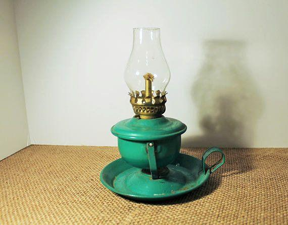 """Decorate your shelves, bookcases, tables and mantle with vintage knick-knacks, like this kerosene lamp. <a href=""""https://www.etsy.com/listing/555392043/vintage-green-metal-hong-kong-mini-oil"""" target=""""_blank"""">Shop it here</a>."""