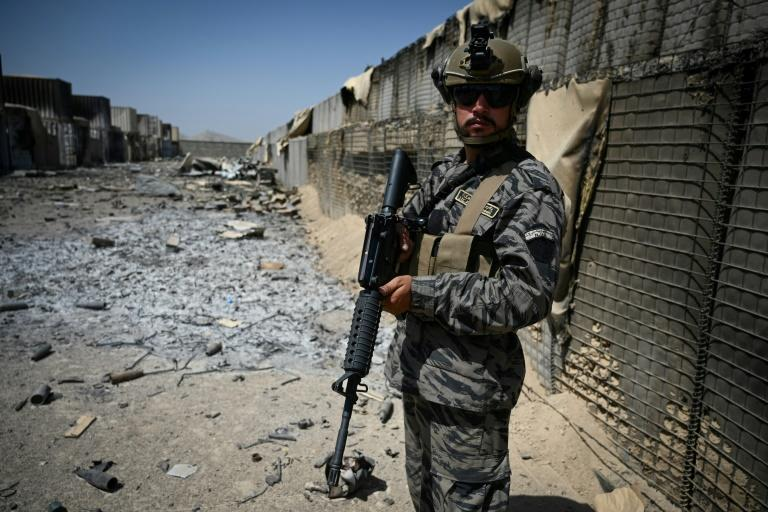 A Taliban Badri 313 unit officer stands guard at the destroyed CIA base in Deh Sabz District (AFP/Aamir QURESHI)