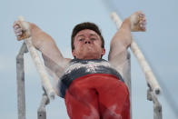 Brody Malone, of the United States, performs on the parallel bars during the artistic gymnastics men's all-around final at the 2020 Summer Olympics, Wednesday, July 28, 2021, in Tokyo. (AP Photo/Gregory Bull)
