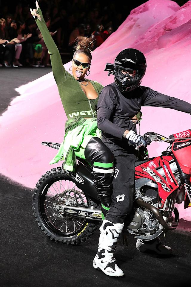 <p>Rihanna never does anything quite like anyone else. For example, the star's New York Fashion Week presentation for her Fenty x Puma line featured some extreme sports, including RiRi on a motocross bike. (Photo: Paul Morigi/WireImage) </p>
