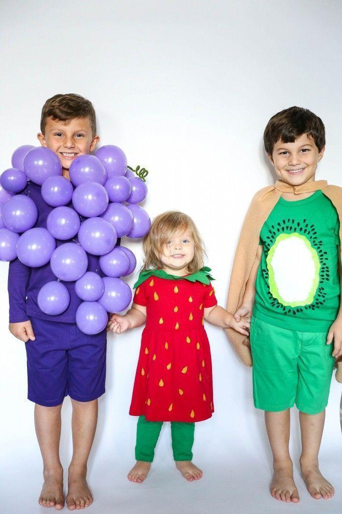 """<p>Pick your favorite fruits (or veggies!), then get to work re-creating them with household supplies. Purple balloons, for instance, make for double-take-worthy grapes.</p><p><strong>Get the tutorial at <a href=""""http://www.taylormadecreatesblog.com/2016/10/group-fruit-costume-kids.html"""" rel=""""nofollow noopener"""" target=""""_blank"""" data-ylk=""""slk:Taylor Made Creates"""" class=""""link rapid-noclick-resp"""">Taylor Made Creates</a>.</strong></p><p><a class=""""link rapid-noclick-resp"""" href=""""https://go.redirectingat.com?id=74968X1596630&url=https%3A%2F%2Fwww.walmart.com%2Fsearch%2F%3Fquery%3Dballoons&sref=https%3A%2F%2Fwww.thepioneerwoman.com%2Fhome-lifestyle%2Fcrafts-diy%2Fg37066817%2Fhalloween-costumes-for-3-people%2F"""" rel=""""nofollow noopener"""" target=""""_blank"""" data-ylk=""""slk:SHOP BALLOONS""""><strong>SHOP BALLOONS</strong></a></p>"""