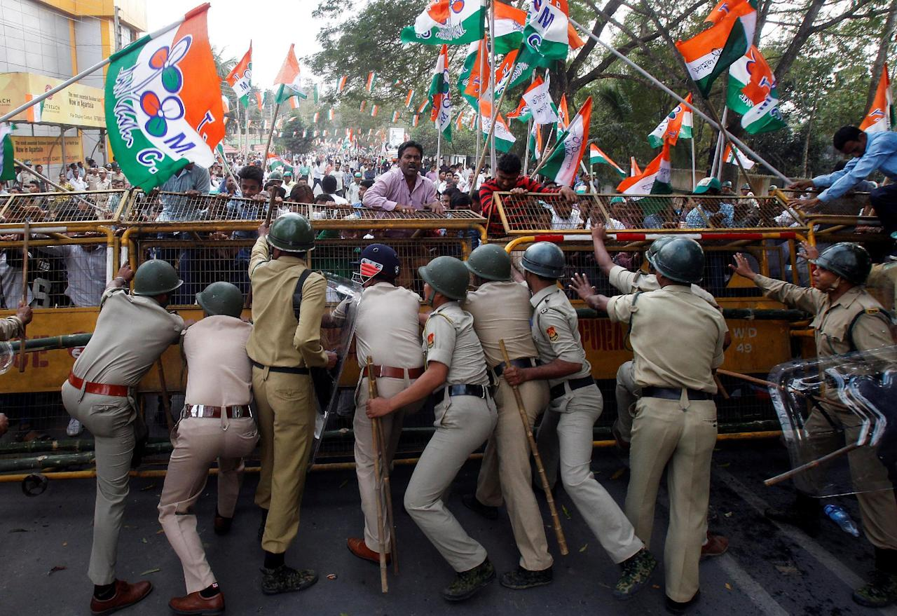 Demonstrators try to cross a police barricade during a protest organized by Trinamool Congress (TMC) party against demonetisation, according to the party organizers, in Agartala, India, February 23, 2017. REUTERS/Jayanta Dey