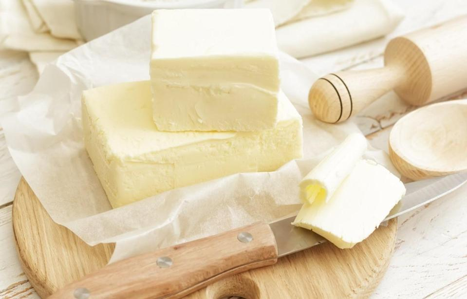 """<p>Many recipes call for your butter to be at room temperature. If you forgot to take your stick of butter out a few hours before baking, don't worry. You can soften a cold stick of butter by placing it in a sealed bag and using a rolling pin to flatten the butter into a thin layer — a <a href=""""https://www.thedailymeal.com/cook/kitchen-hacks-from-parents-gallery?referrer=yahoo&category=beauty_food&include_utm=1&utm_medium=referral&utm_source=yahoo&utm_campaign=feed"""" rel=""""nofollow noopener"""" target=""""_blank"""" data-ylk=""""slk:cooking hack you probably learned from your parents"""" class=""""link rapid-noclick-resp"""">cooking hack you probably learned from your parents</a>. A rubber spatula will help you scoop the soft butter out.</p>"""