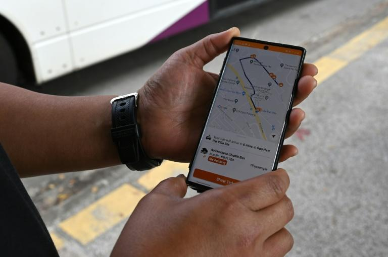 Passengers can book a seat on one of the self-driving buses through an app