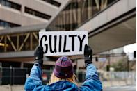 "<p>A protester holds a ""guilty"" sign outside the Courthouse In Minneapolis on April 19, a day before Chauvin was found guilty on all counts. </p>"
