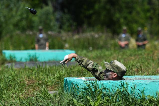 <p>A serviceman of the Russian Armed Forces during the Scout Trail obstacle course, a stage of the Army Scout Masters competition among reconnaissance units, as part of the 2018 International Army Games at the Koltsovo range in Novosibirsk region, Russia on Aug. 2, 2018. (Photo: Kirill Kukhmar/TASS via Getty Images) </p>
