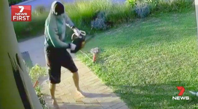 Security vision captured the hooded man taking the weapon to the front door. Photo: 7 News